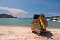 Wooden boat on the beach with blue sky from front Stock Images