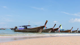 Wooden boat on the beach Royalty Free Stock Images