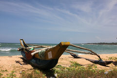 Wooden boat on the beach Stock Image