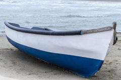 Wooden boat on the beach. Wooden boat on sandy beach Stock Image