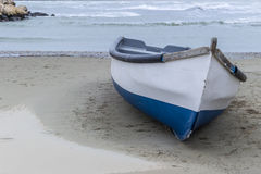 Wooden boat on the beach. Wooden boat on sandy beach Royalty Free Stock Photo