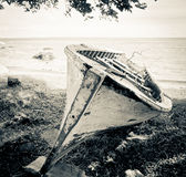 Wooden boat on the beach in sepia Royalty Free Stock Photo