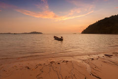 Wooden boat on a beach at sunset. Wooden boat on a beach at sunset Royalty Free Stock Image