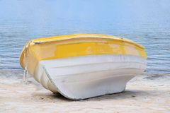 Wooden boat on the beach Royalty Free Stock Image