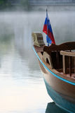 Wooden boat on Bled lake Stock Photo