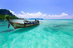 Wooden boat and blue water ocean Stock Photo