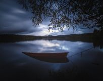 Wooden Boat By The Lake Shore, Norway, Beautiful Autumn Time, Calm Water Stock Photography