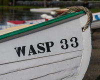 Wooden Boat Called Wasp 33 on Thorpeness Meare. A wooden boat called Wasp 33 on Thorpeness Meare, Suffolk, England royalty free stock photo