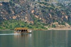 Wooden Boat Carries Tourists. On sunken village Savasan in Halfeti, Sanliurfa, Turkey Royalty Free Stock Image