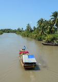 Wooden boat carry flowers to the market in Mekong Delta, Vietnam Stock Photography