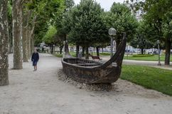 Wooden boat in in city park of Coimbra in Portugal. Coimbra, Portugal - July 2014: wooden boat in in city park of Coimbra stock images