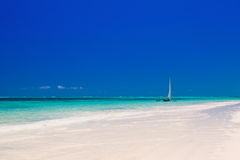 Wooden boat in crisp blue water Stock Photography