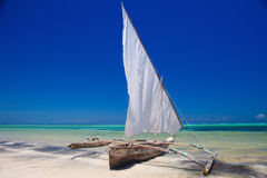 Wooden boat in crisp blue water Stock Photo