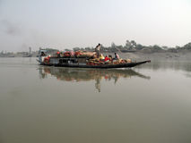 Wooden boat crosses the Ganges River in Sundarbans, West Bengal, India Stock Photography
