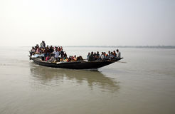 Wooden boat crosses the Ganges River in Sundarbans, West Bengal, India stock photo