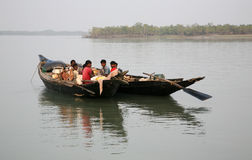 Wooden boat crosses the Ganges River in Sundarbans, West Bengal, India royalty free stock image