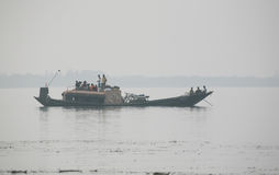Wooden boat crosses the Ganges River in Sundarbans, West Bengal, India royalty free stock images