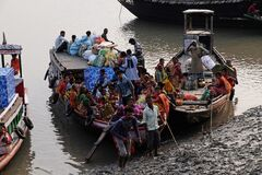 Wooden Boat Crosses The Ganges River In Sundarbans, India Stock Photo