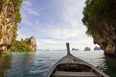 Wooden boat cruising around the islands in the sea in Thailand Royalty Free Stock Image