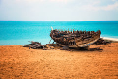 Wooden boat in decay by the sea, on the beach. Stock Images