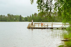 Wooden boat dock on lake. Purhon Campsite, Hamina, Finland, Suom Royalty Free Stock Photo