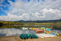Wooden boat dock with moored boats Stock Photography