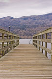 Wooden boat dock Stock Photo