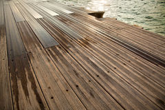 Wet Wooden Dock & Sea Stock Image