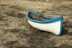 Wooden boat on the dry shore Royalty Free Stock Photos