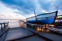 Wooden boat in a fishing village at sunset Royalty Free Stock Image