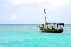 Wooden boat floating on the turquoise sea Royalty Free Stock Images