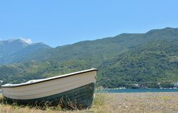 Wooden boat. A wooden boat in front of a scenic mountain background Royalty Free Stock Photo