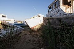 Wooden Boat Graveyard. Wooden fishing boat graveyard Tangier island were old boat are taken to retire Stock Photos