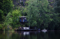 Wooden boat house in the lake Royalty Free Stock Photo