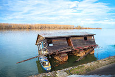 Wooden boat and house Stock Photography