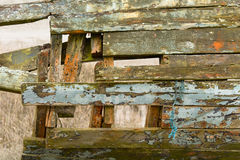 Wooden boat hull rotting with flaking paint Royalty Free Stock Photo