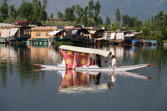 Wooden boat and indian people in lake. Srinagar,  India Royalty Free Stock Images