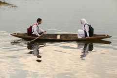 Wooden boat and indian people in lake. Srinagar,  India Stock Photo