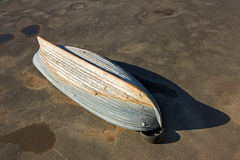 Wooden boat inverted bottom up Royalty Free Stock Photography