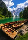 Wooden boat at lake Braies, Dolomites mountains, Italy stock photography