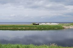 Wooden boat on the Lake Peipsi Chudskoe lake shore, overcast. Estonia landscapes royalty free stock photos