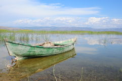 Wooden boat on lake (sea) Royalty Free Stock Photo