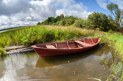 Wooden boat at the lake in summer day Stock Photo
