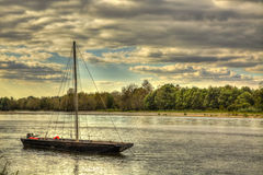 Wooden Boat on Loire Valley. Wooden boat on the Loire Valley in France during an autumn evening day Stock Image