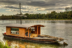 Wooden Boat on Loire Valley. Wooden boat on the Loire Valley in France during an autumn evening day Royalty Free Stock Image