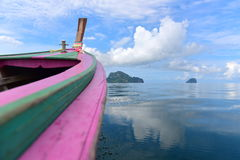 Wooden boat making its way to the hilly islands Royalty Free Stock Photography