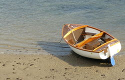 Wooden boat moored on beach Royalty Free Stock Photos