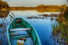 The wooden boat moored on lake ashore in Russian rural nature Royalty Free Stock Images