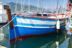 Wooden boat moored in Propriano, Corsica. Small blue and white wooden fishing boat moored in Propriano town, Corsica, France Royalty Free Stock Photos