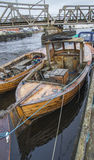 Wooden boat moored on the river pier Royalty Free Stock Photos